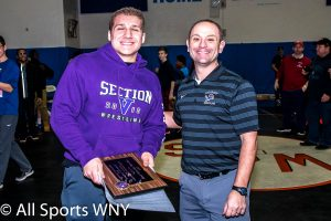 William Bolia of Fairport receives MOW Award from Coach John Scapelliti of Lockport.